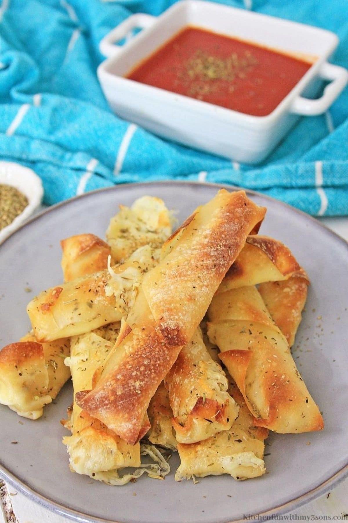Air fryer wonton mozzarella sticks on blue plate