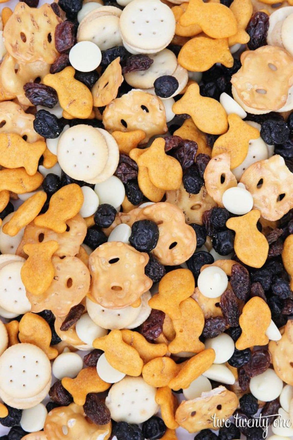 Snack mix with pretzels raisins and goldfish
