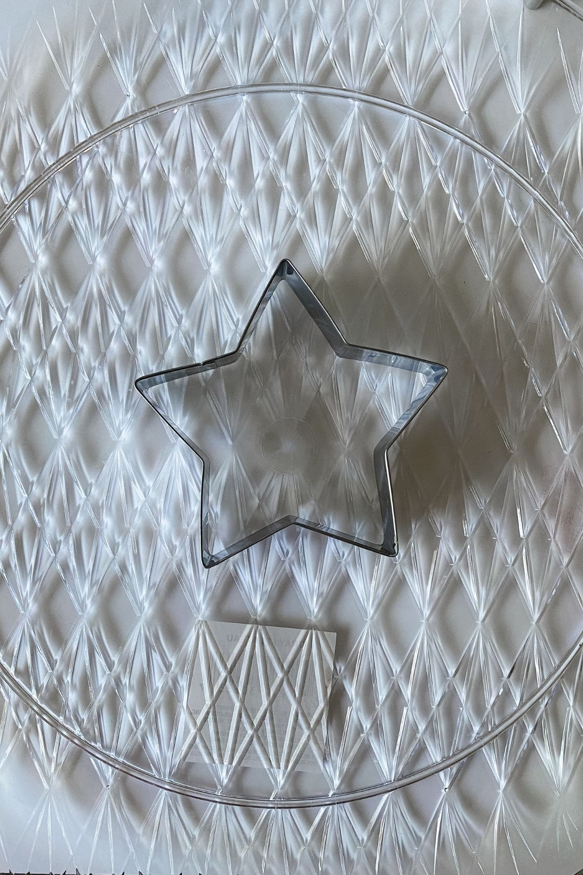 Large star cookie cutter in center of round platter