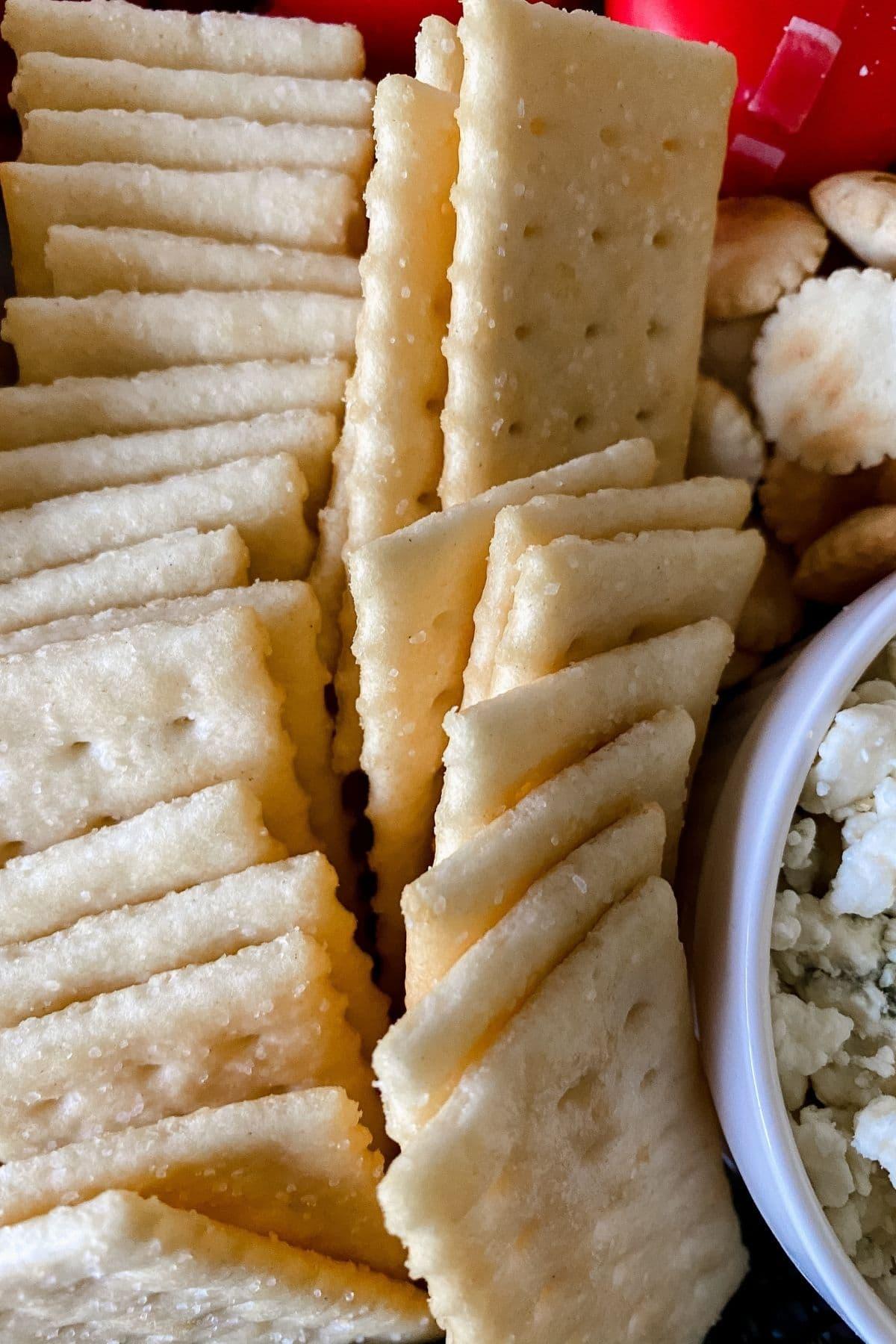 Club crackers on platter by ramekin