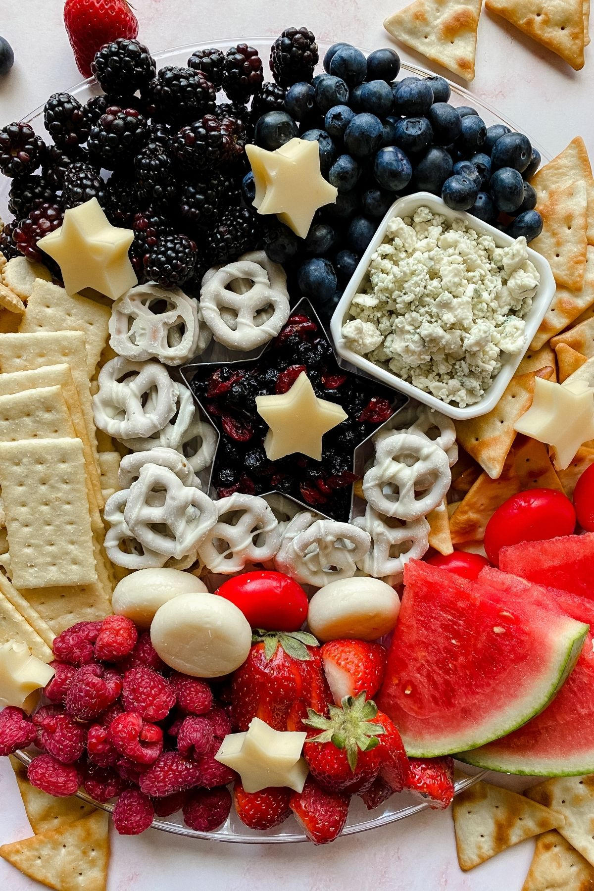 Snack platter with berries crackers and cheese
