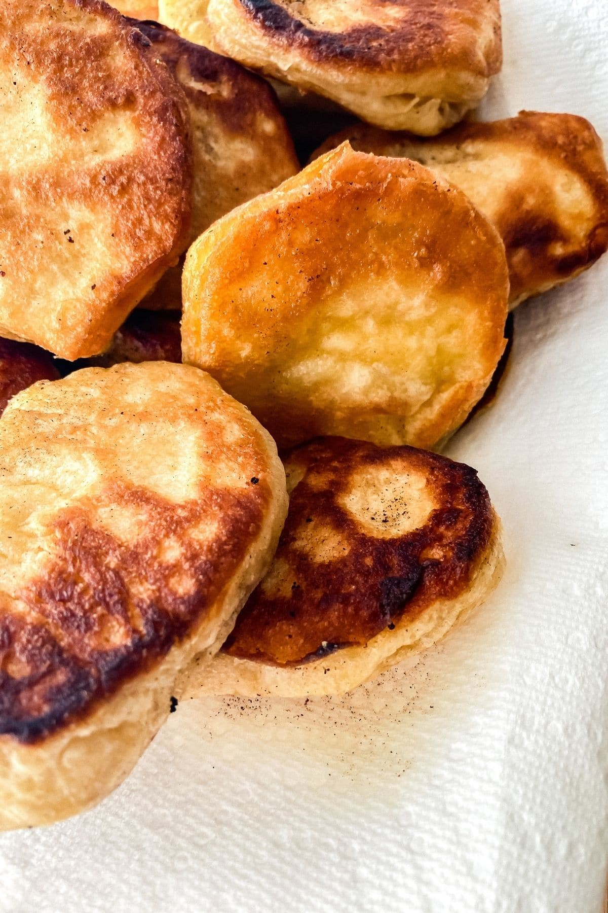 Fried biscuits on paper towels