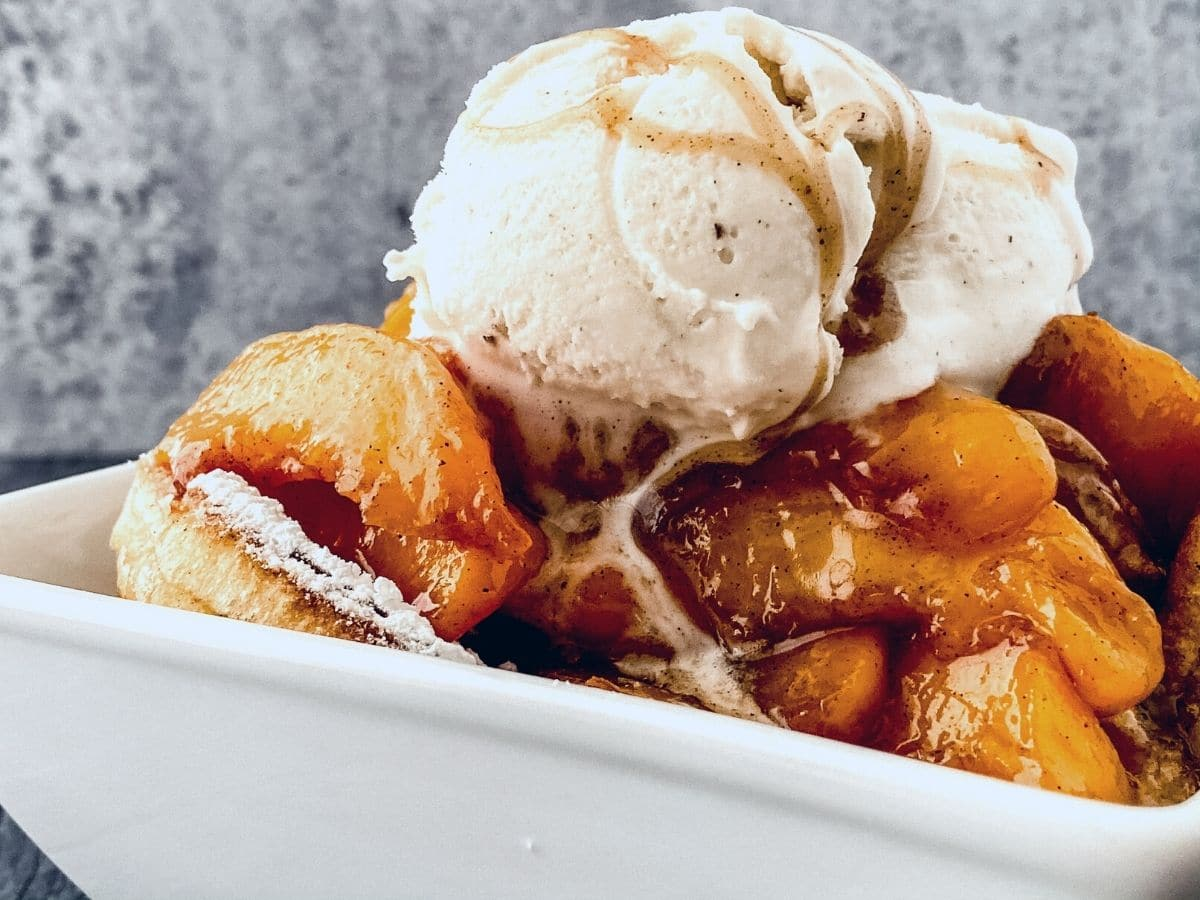 Cobbler in bowl topped with ice cream
