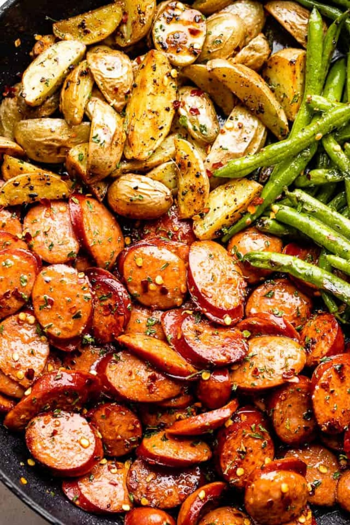 Sausage potatoes and green beans seasoned in skillet
