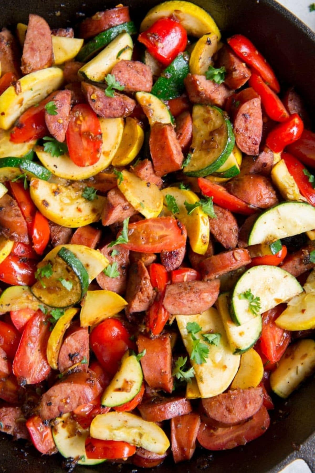 Sausage and zucchini in cast iron skillet