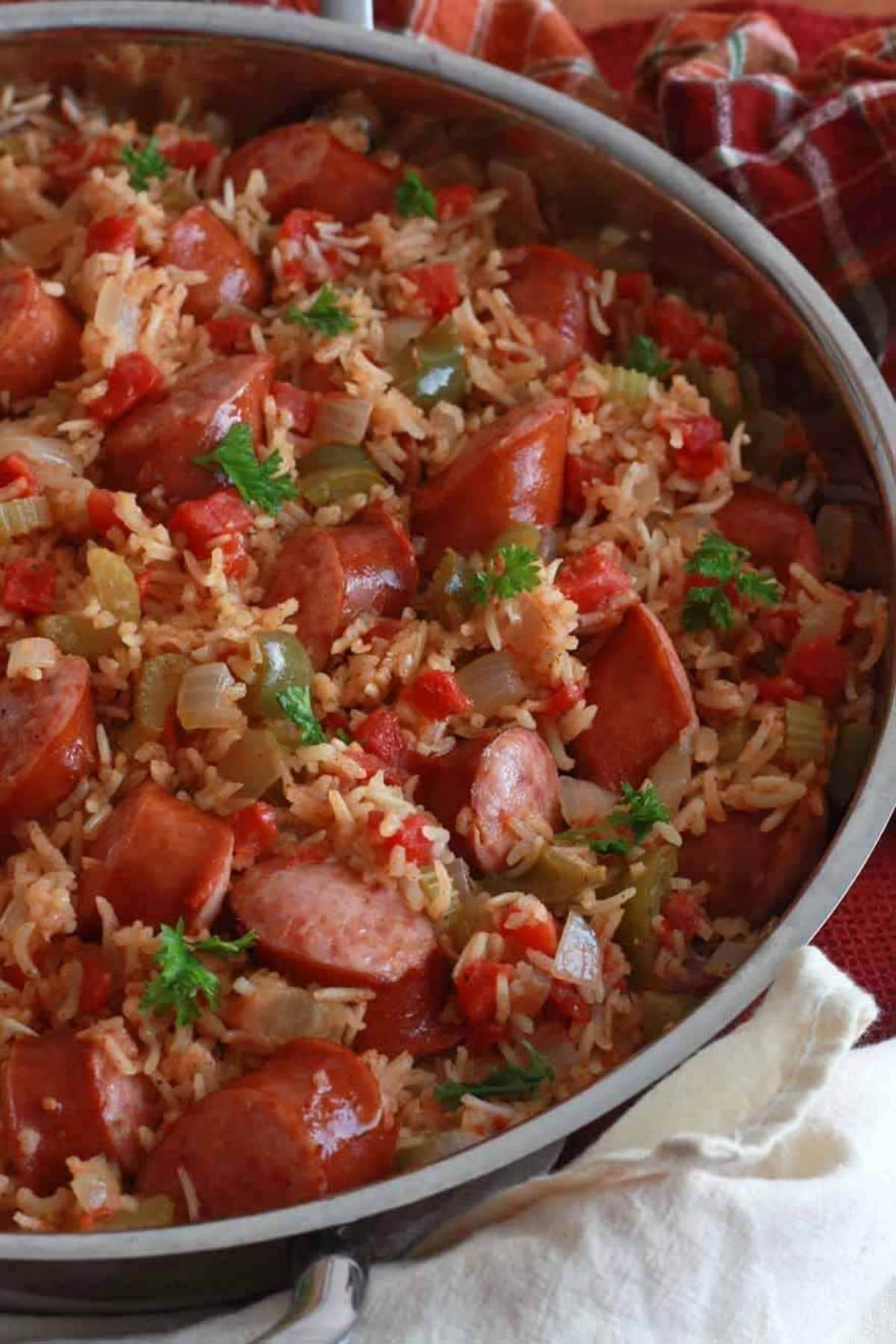 Large skillet filled with rice and sausage