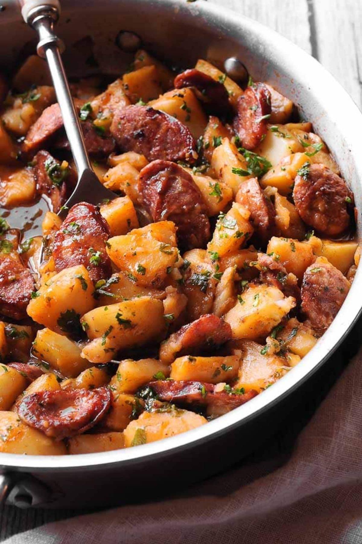 Spoon in bowl of potatoes