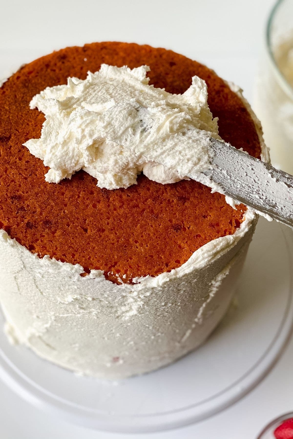 Adding frosting to top of cake