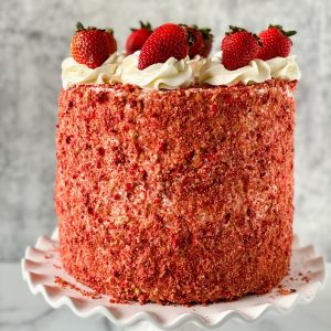 Cake with strawberries on top and gray background