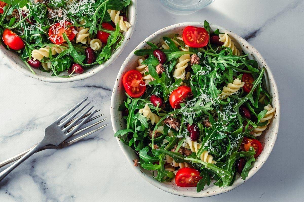 Yummy Mediterranean salad served in rustic bowls.