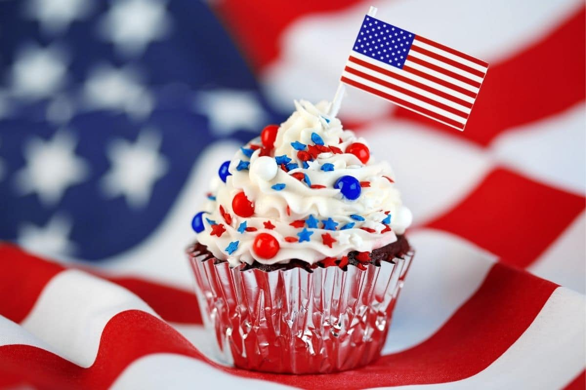 Cupcake on American flag tablecloth with mini flag decoration
