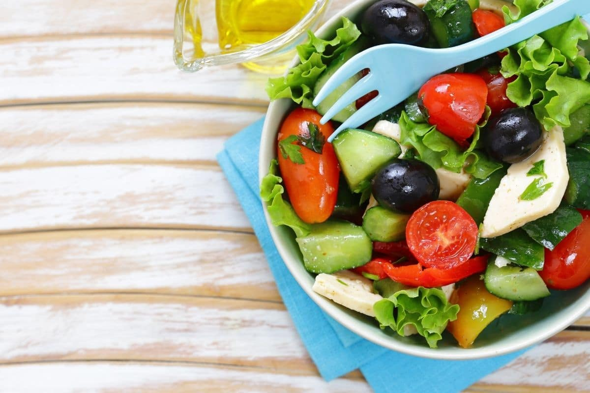 a Mediterranean salad with tomatoes, black olives and feta cheese