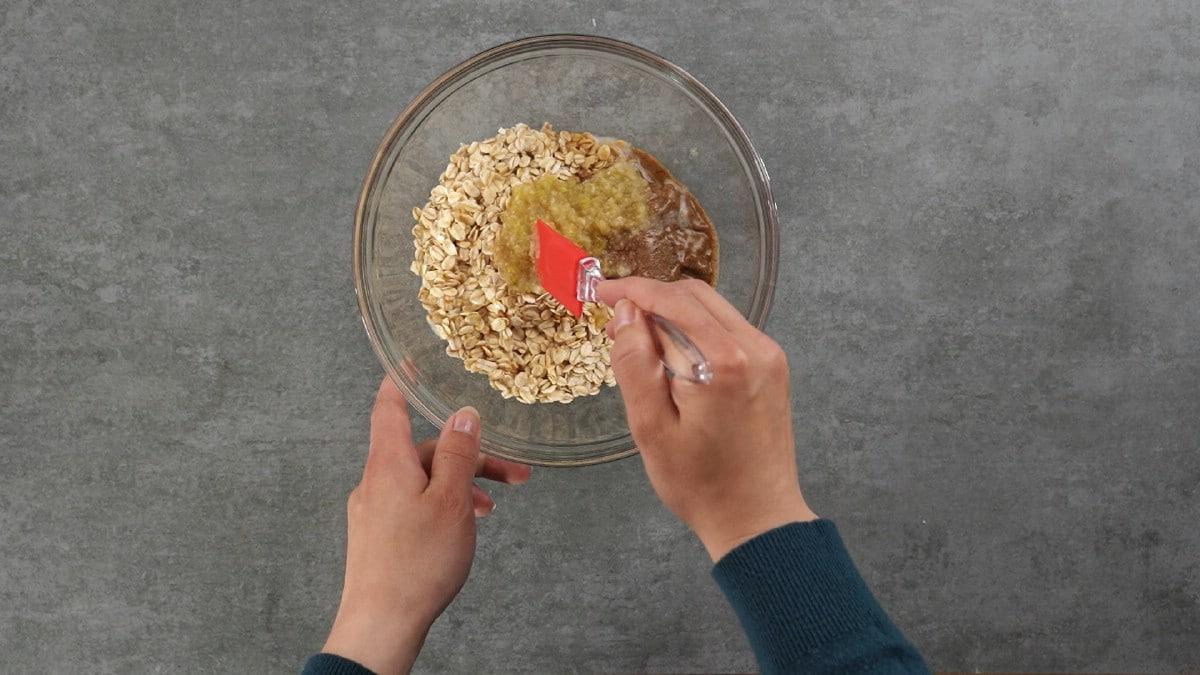 Stirring granola in glass bowl
