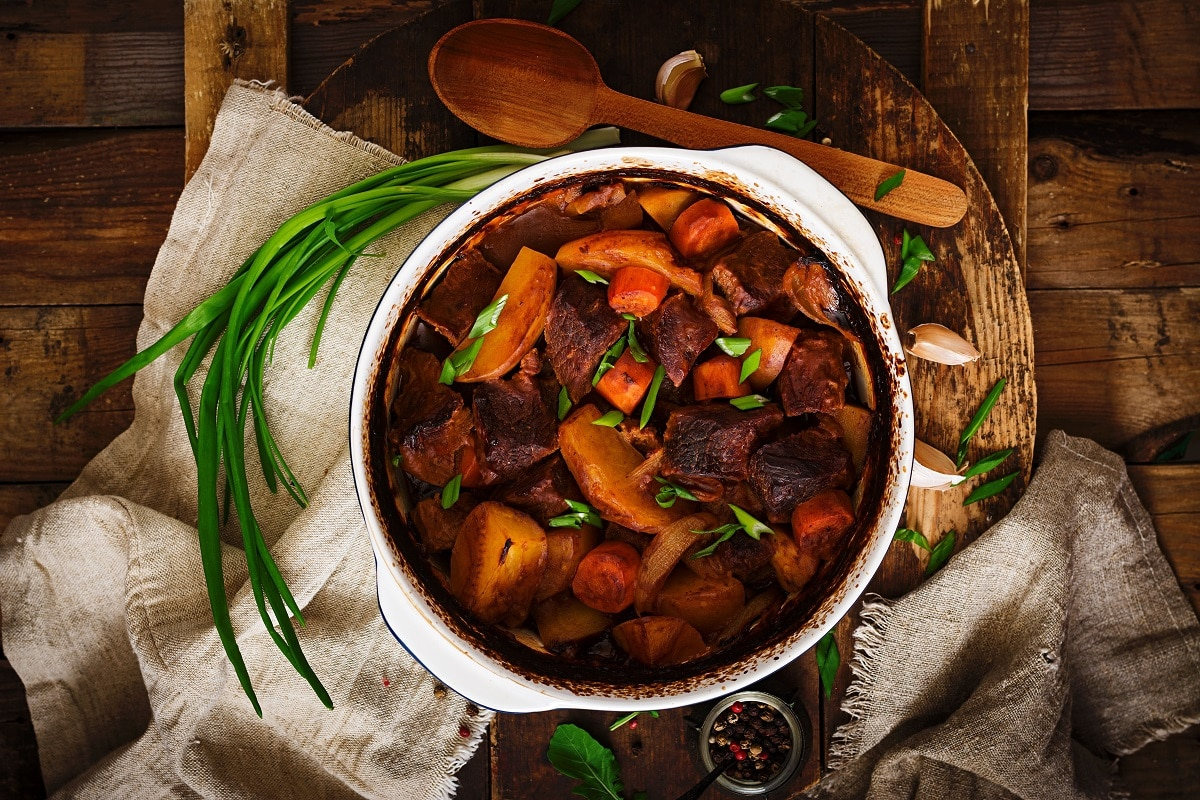 Boeuf bourguignon garnished with chives in a casserole