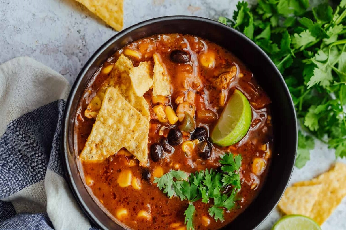 Chicken and Tortilla Soup made with beans, corn, and jalapenos for a kick of flavor