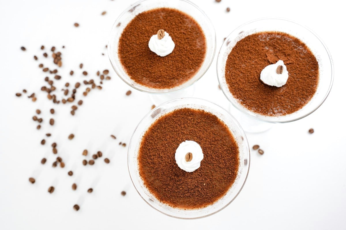 Image looking down onto top of three dessert cups of panna cotta