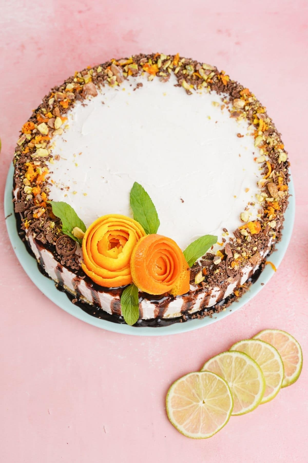 Orange roses and chocolate crumbs on top of cheesecake