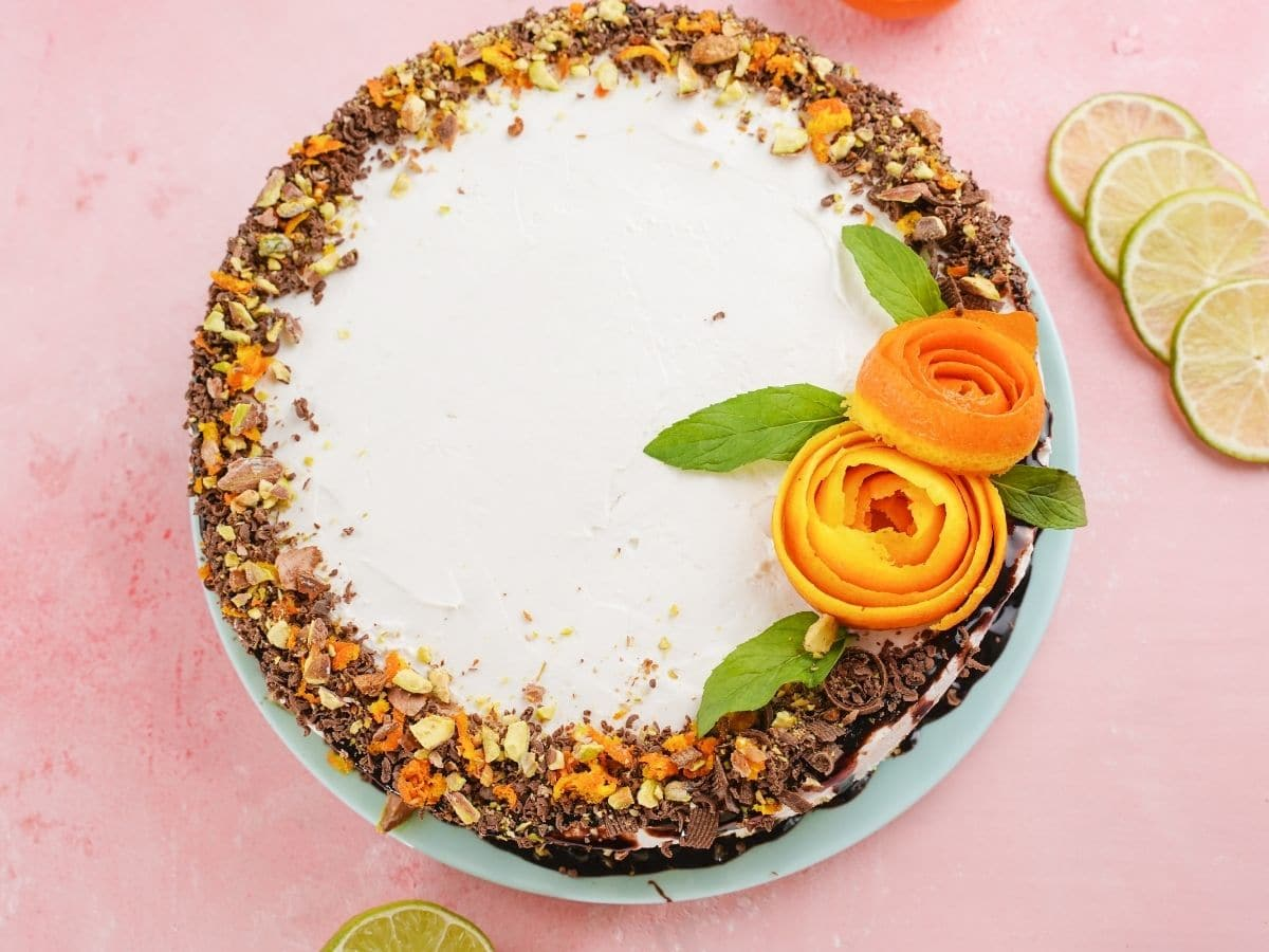 Overhead picture of decorated cheesecake on pink table