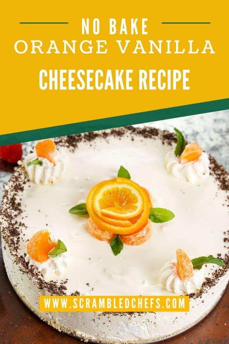 Cheesecake with orange rose in center on brown table with orange overlay that says no bake orange vanilla cheesecake recipe