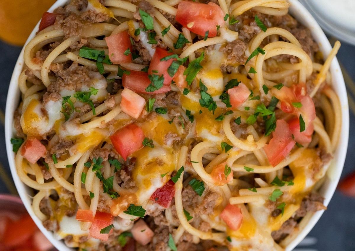 Dutch oven cheesy taco spaghetti in a bowl