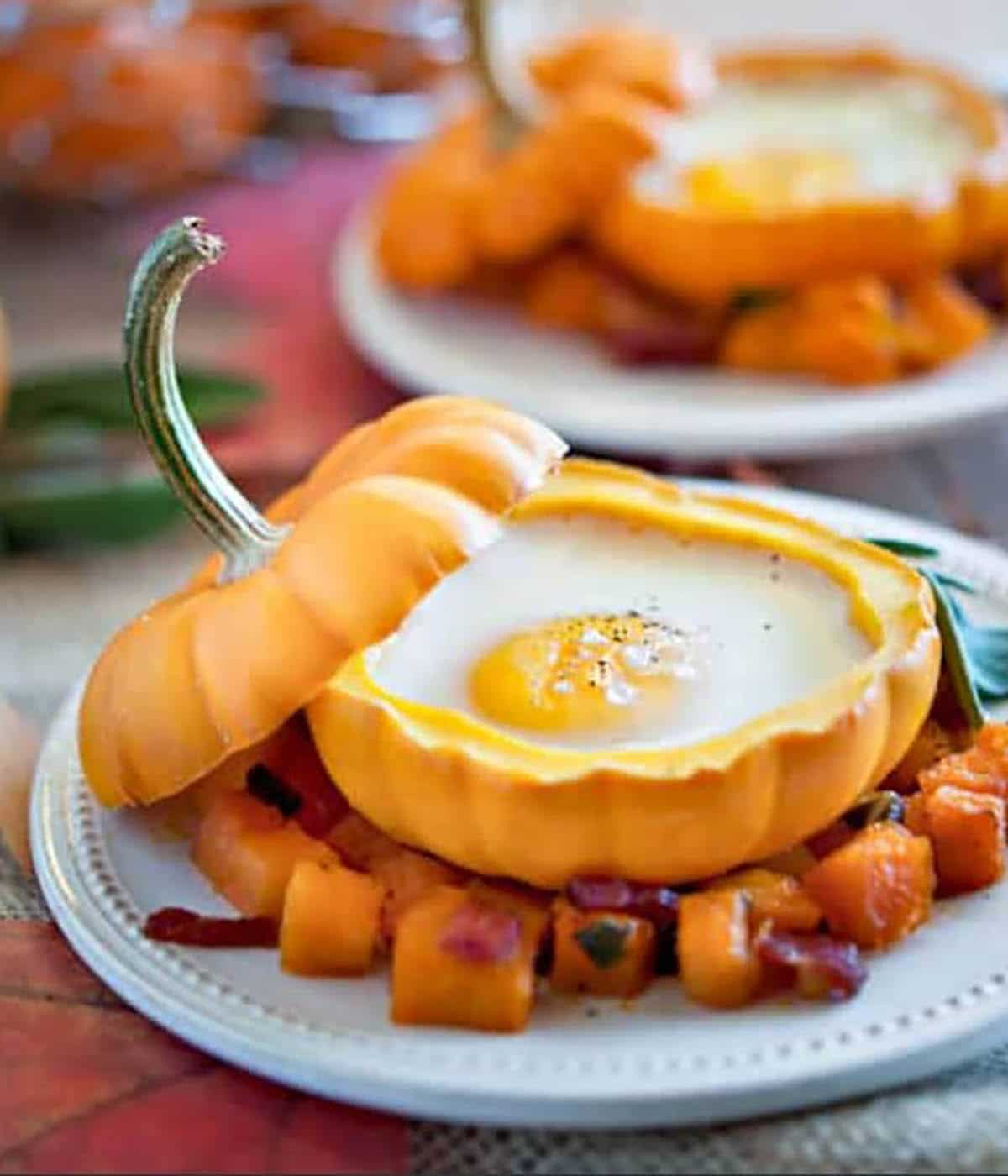 baked baby pumpkin with egg on top of squash sauteed with onions and diced bacon with vinaigrette