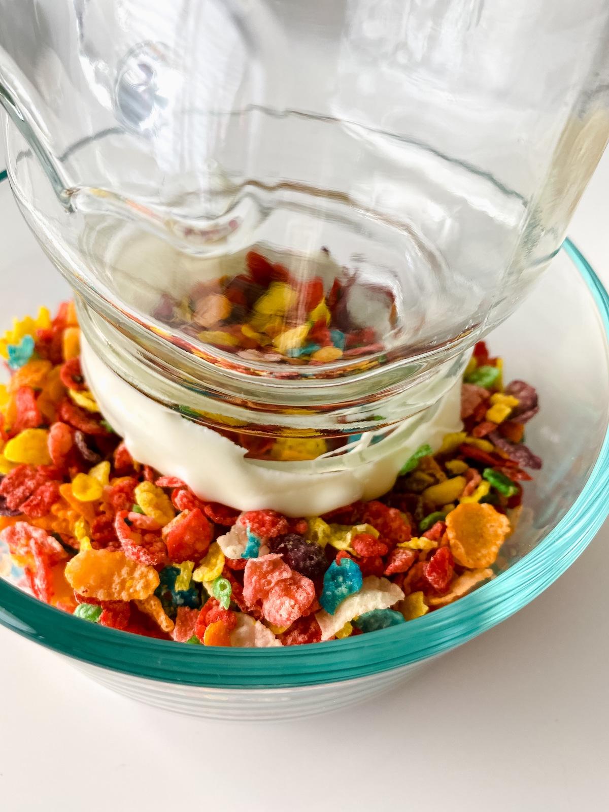 Dipping mug rim into bowl of cereal