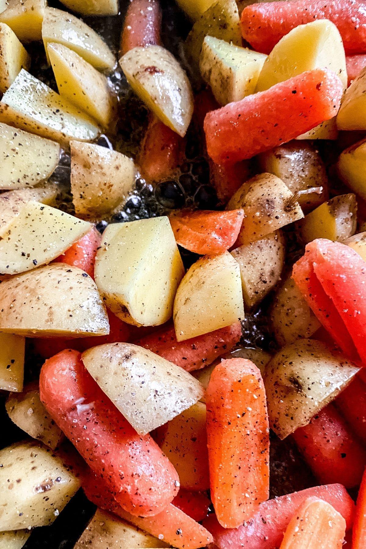 Potatoes and carrots seasoned in pan