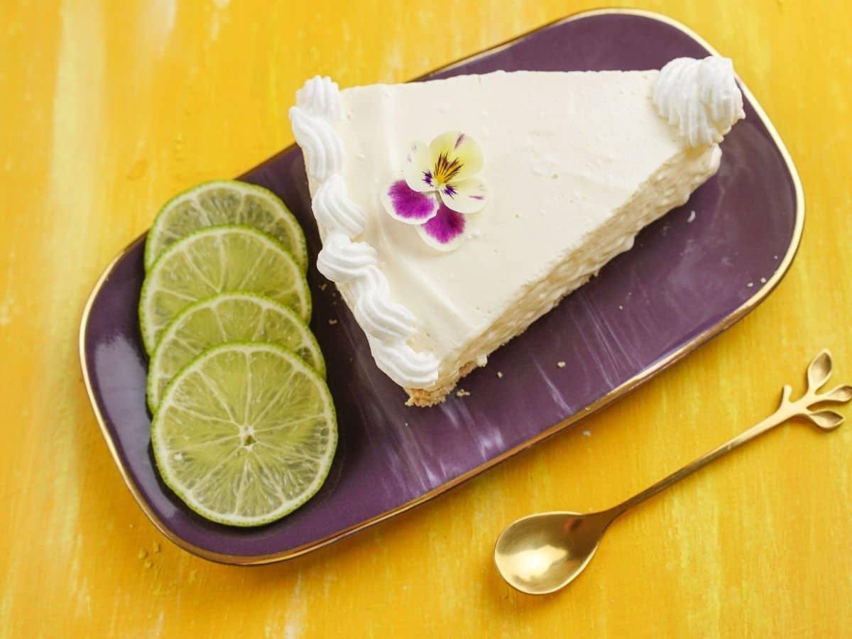 Overhead image of slice of pie on purple plate