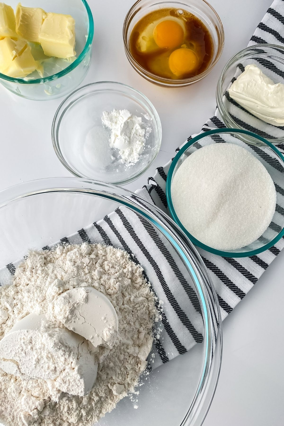 Ingredients for Lofthouse cookies in glass bowls on table