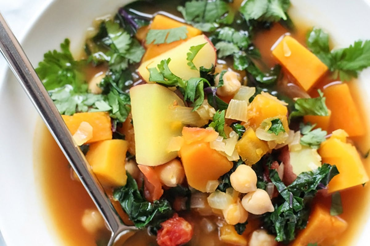 Close up of a bowl of Moroccan soup With Kale and Chickpeas