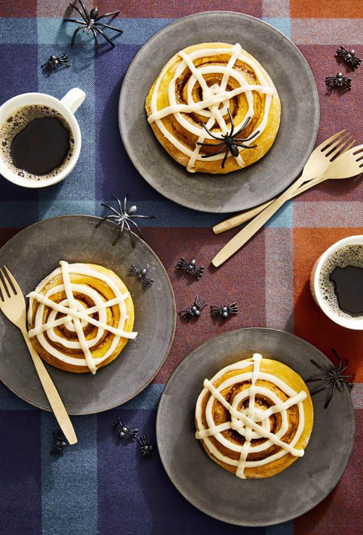 Pumpkin-Spiced Buns With Cream Cheese Spider-Web Glaze