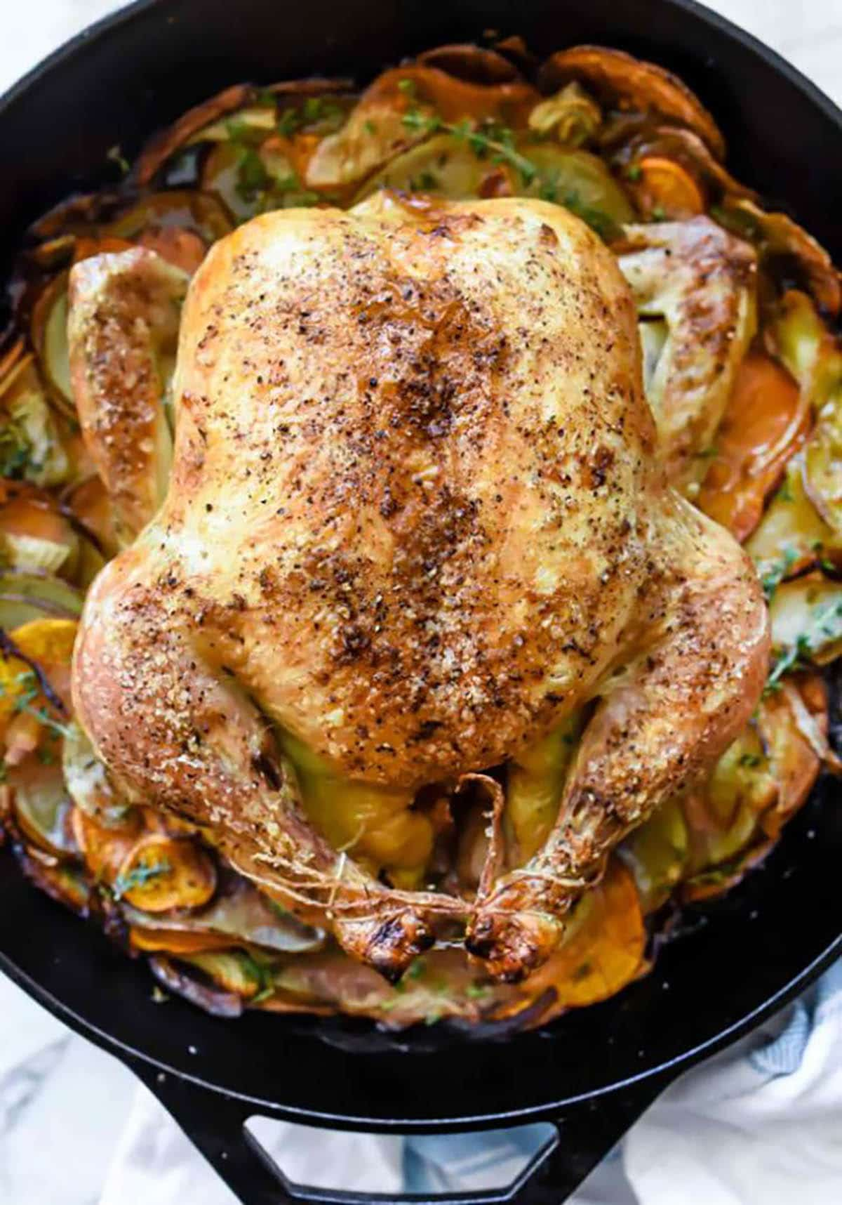 Roasted Chicken With Potatoes in a cast iron pan