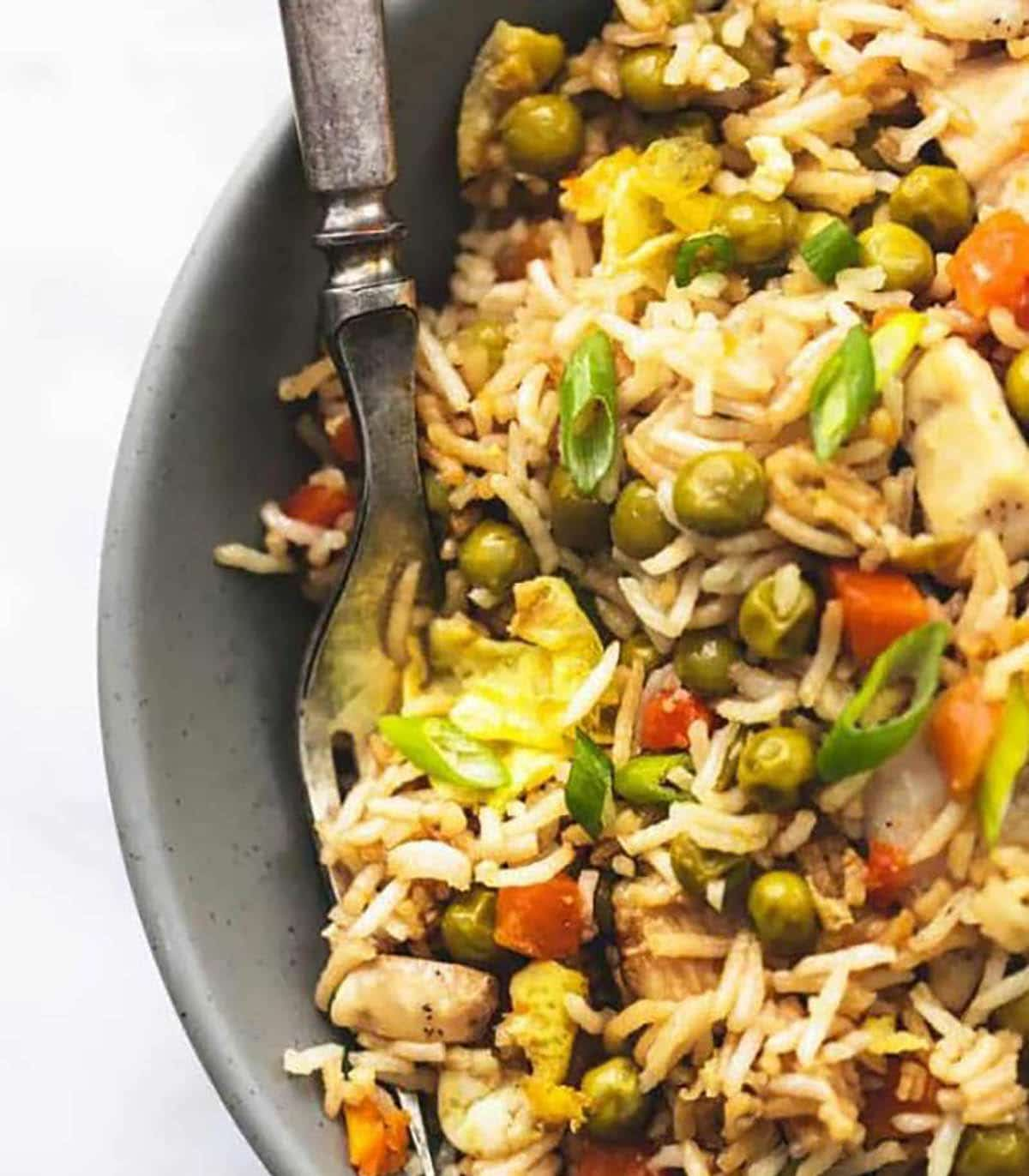 Sheet Pan Chicken Fried Rice topped with green peas and green onions
