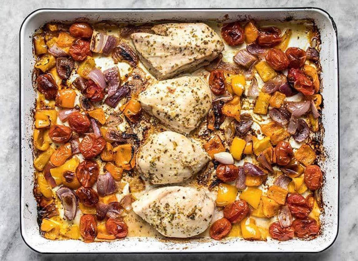 Sheet Pan Greek Chicken and Vegetables in a ceramic pan