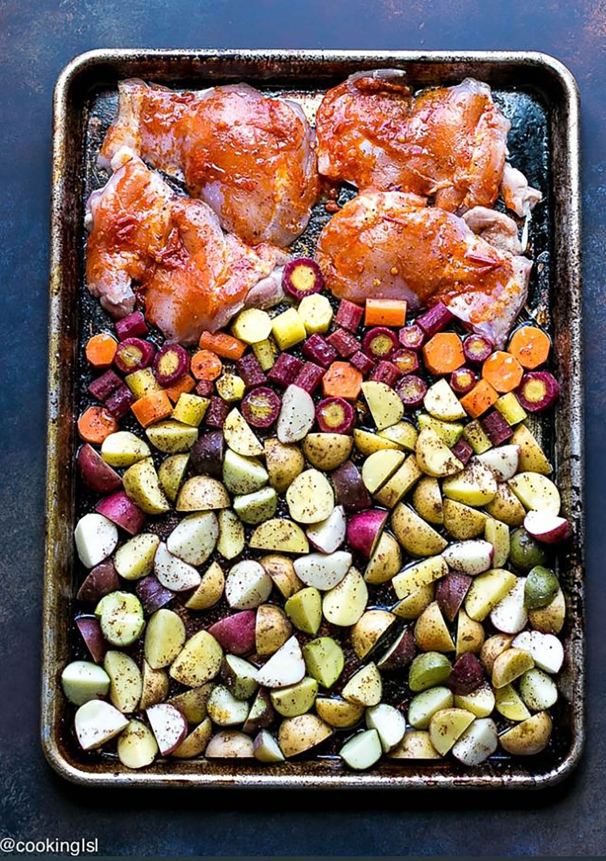 Sheet Pan Harissa Chicken and Vegetables in a baking pan