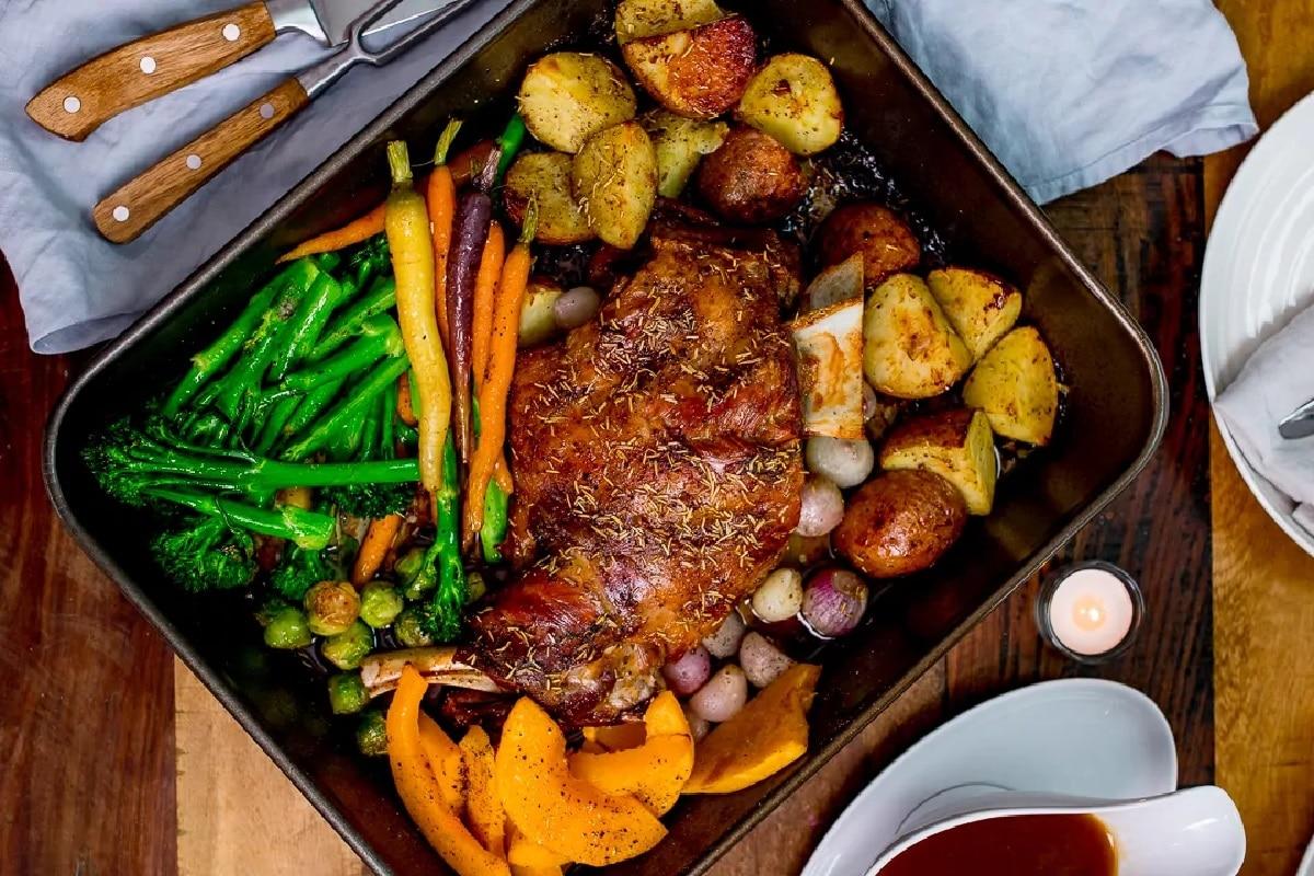 Slow roast shoulder of Welsh lamb with vegetables and cider gravy