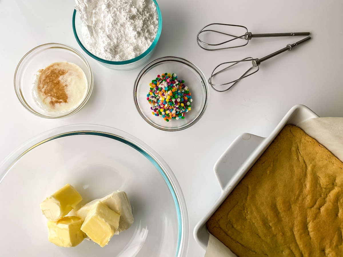 Ingredients for frosting in glass bowls on table