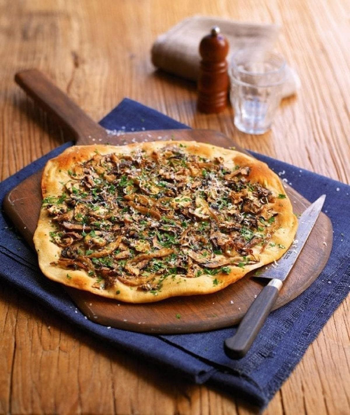 Truffle mushroom pizza on a pizza board