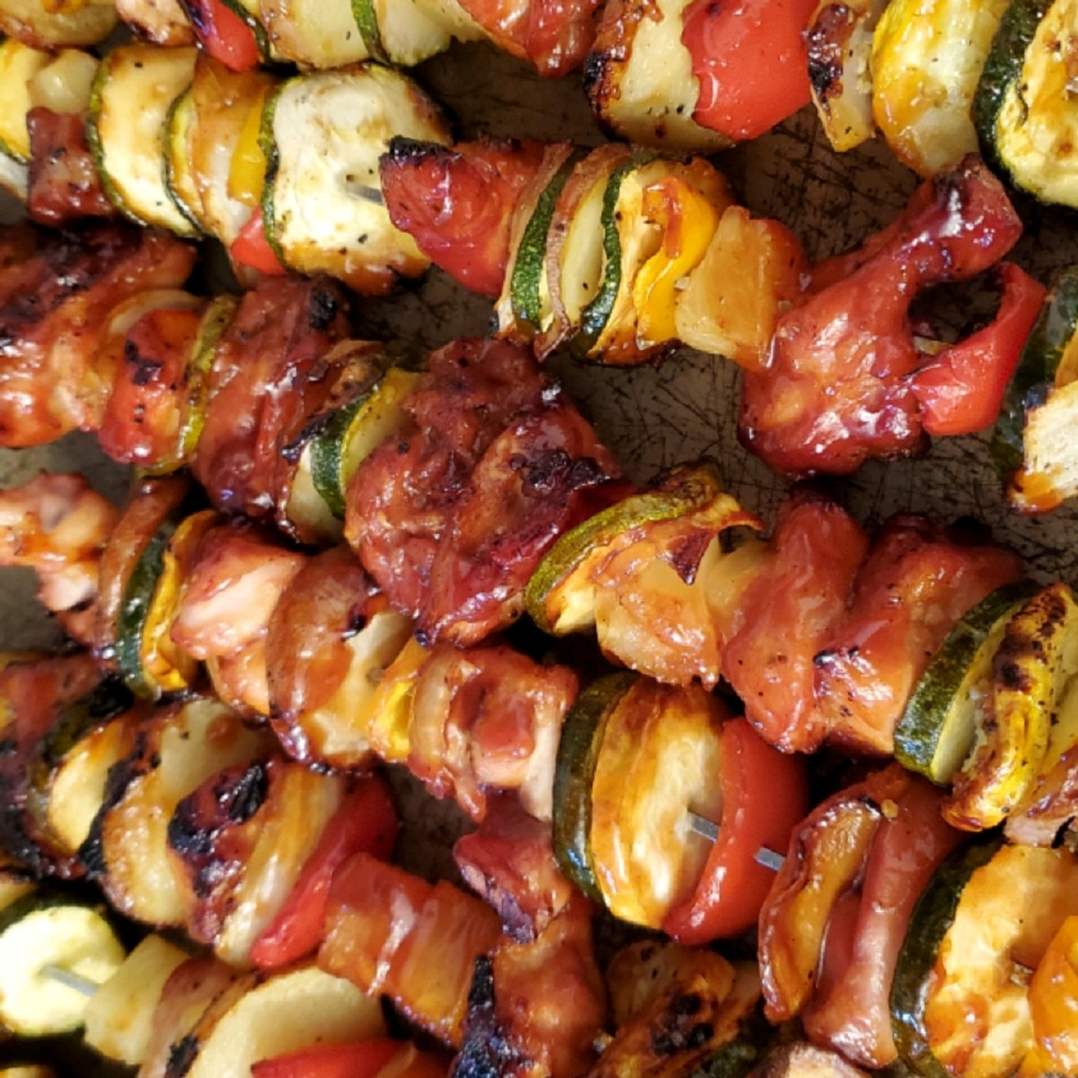 Kabobs on tray with chicken tomato and zucchini