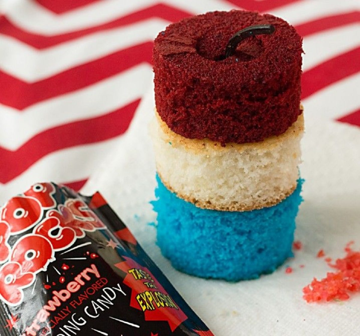 Triple layered cake with blue white and red cake looking like a firework on paper towel