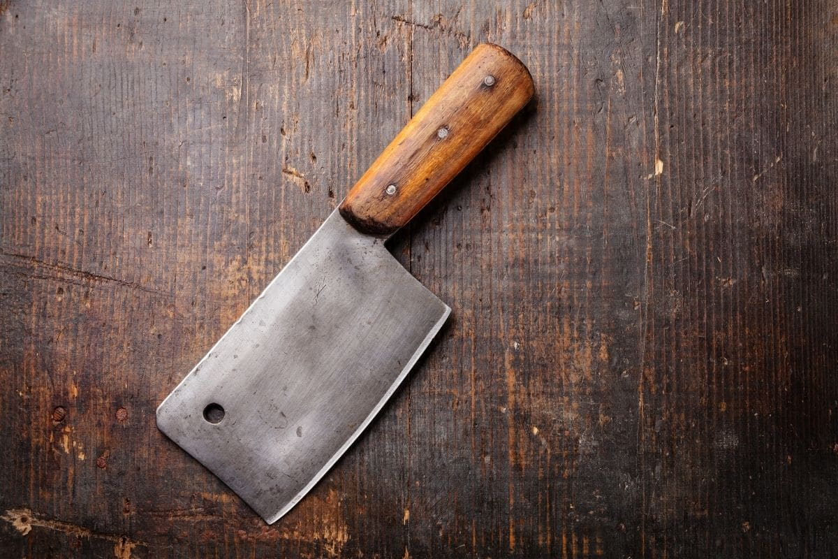 Vintage Meat cleaver with a wooden handle on a wooden table