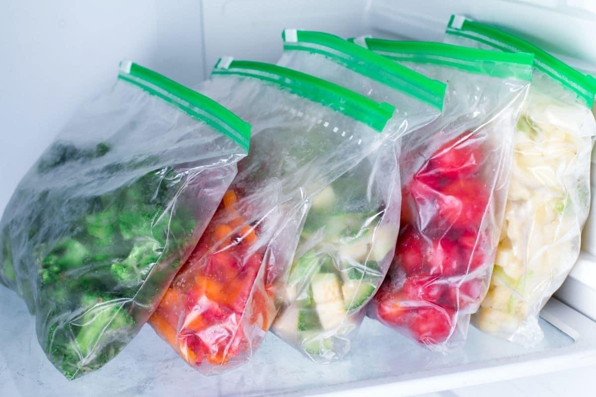 Freezer Bags with Frozen Vegetables in Refrigerator