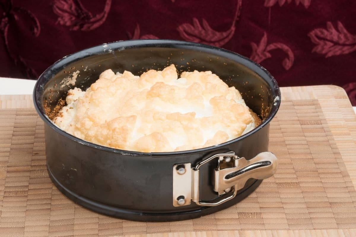 Meringue Cake in a Black Springform Pan with Silver Buckle