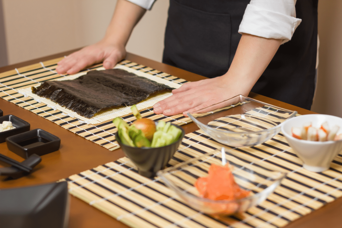 Chef preparing to make japanese sushi roll