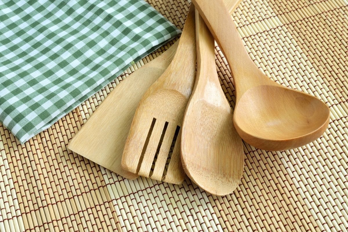 Wooden Kitchen Utensil Set on a Table with a Napkin on the Side