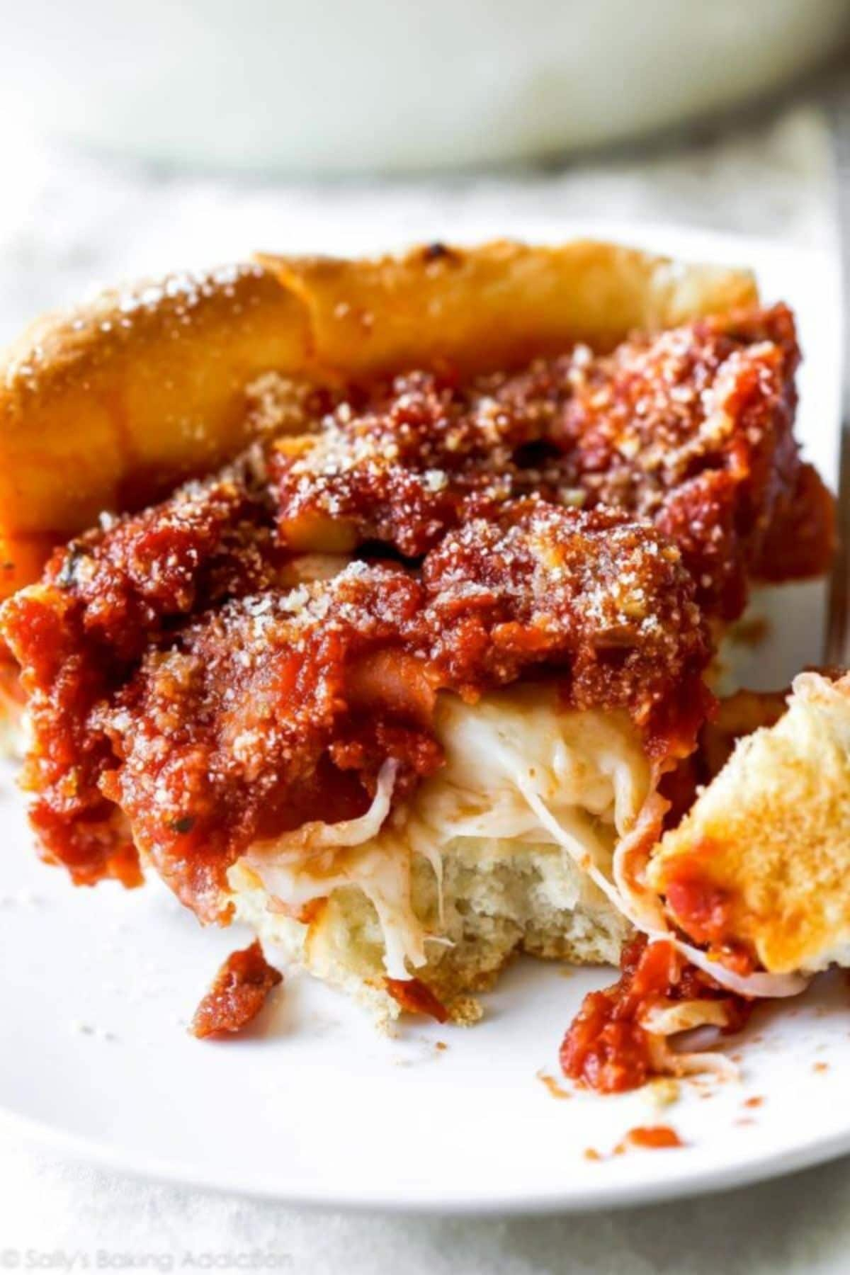cheese pizza with tomato sauce on top on plate