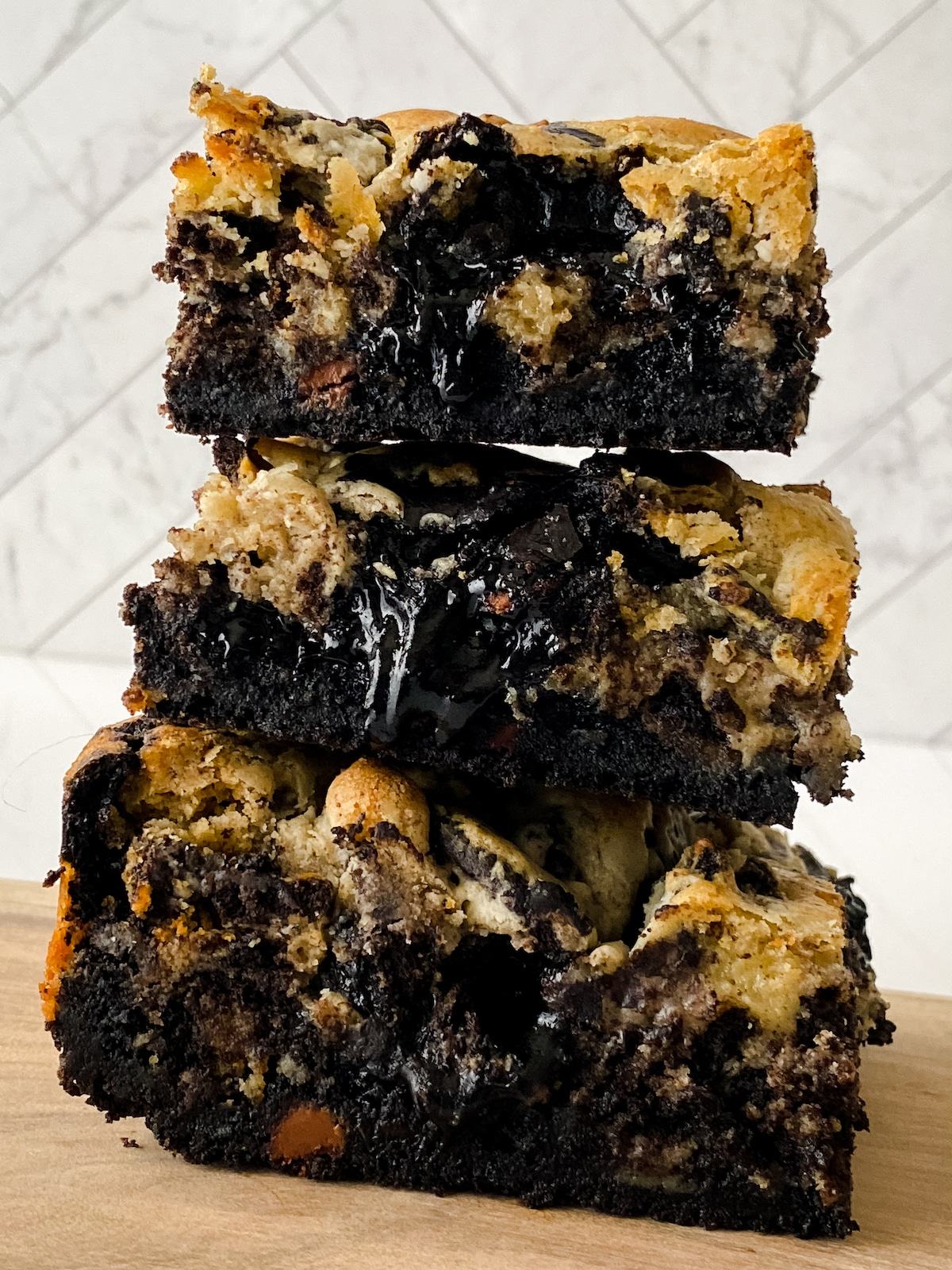 Three brownies with oozing chocolate stacked