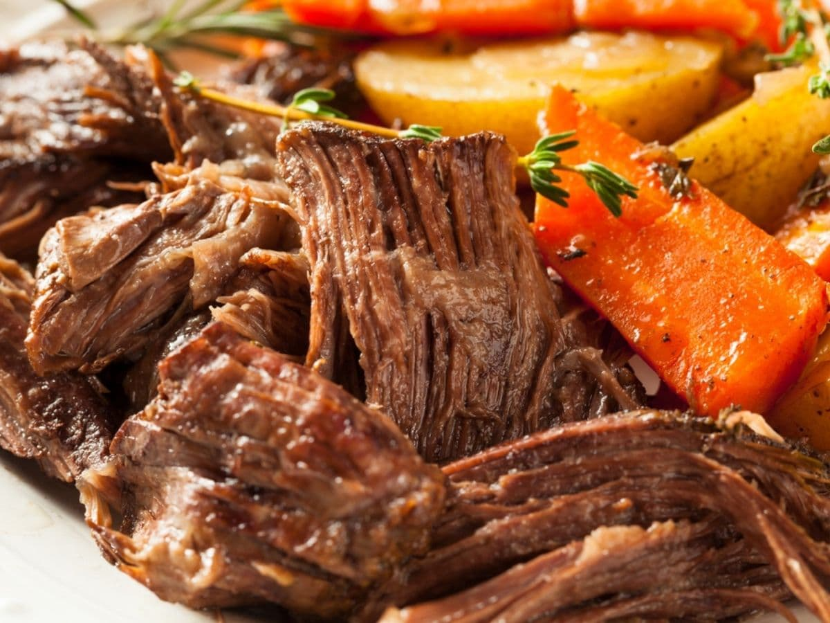 Close up image of pot roast with potato and carrots