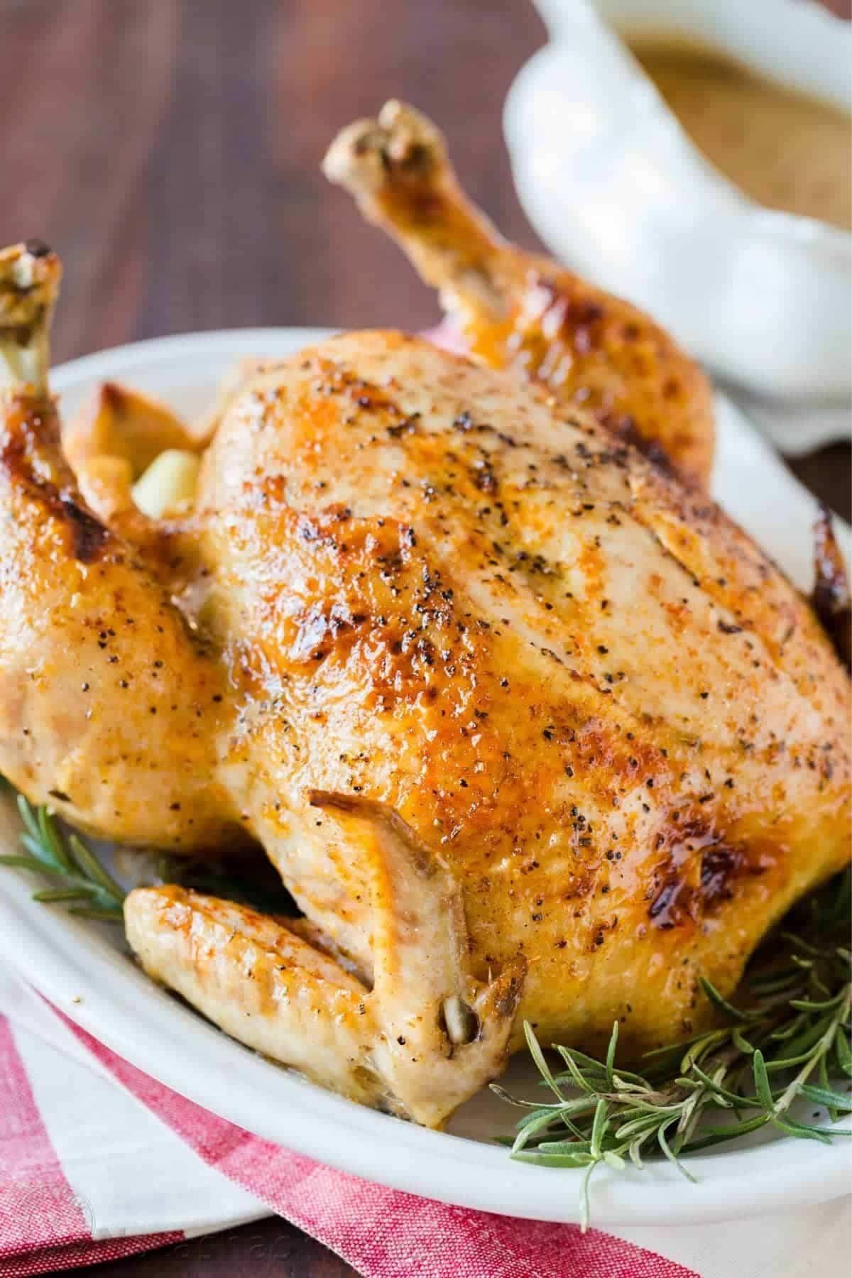 Whole chicken on white platter