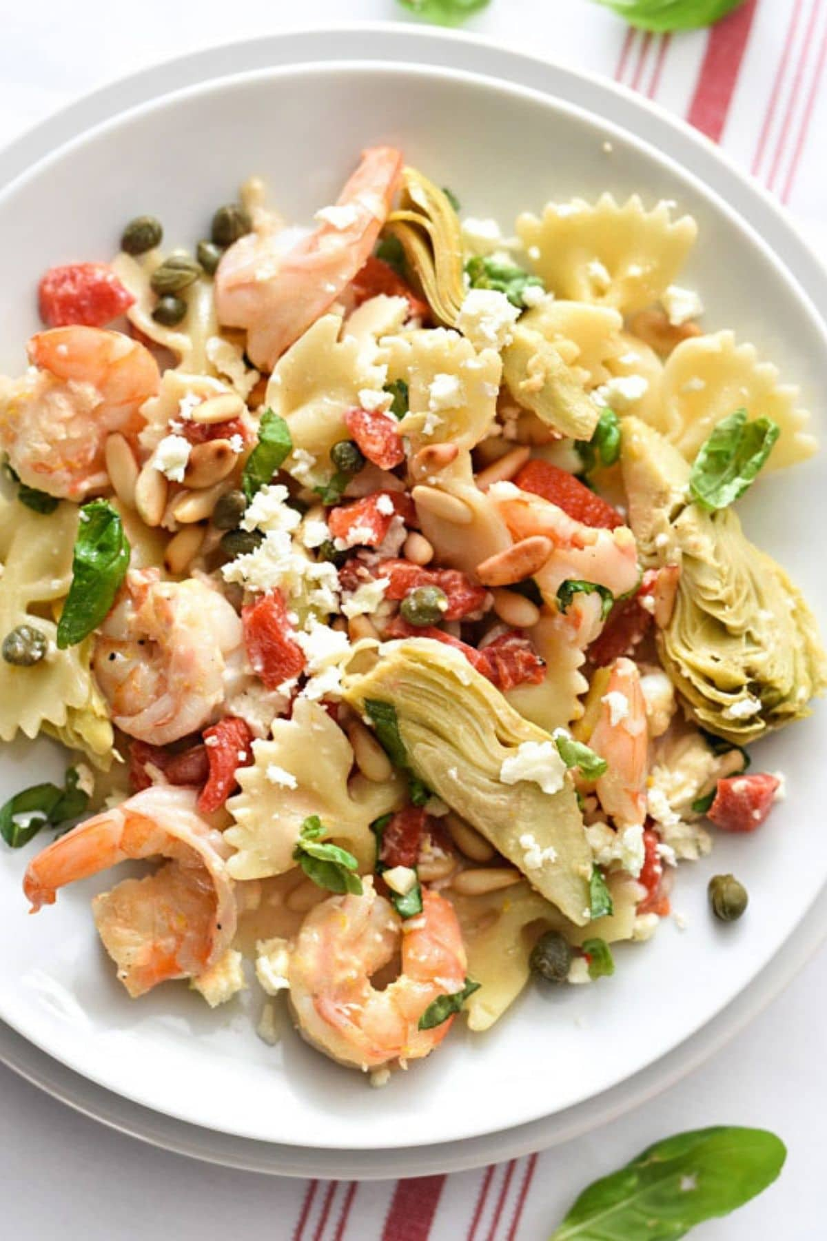 Shrimp and feta on white plate with pasta